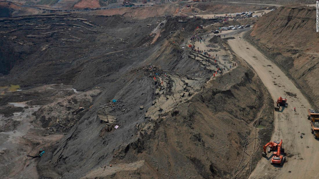 More than 50 jade mine workers trapped by 'mud lake'