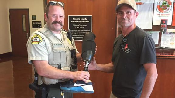 An officer reunites Dion with his prosthetic leg.