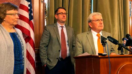 Iowa Rep. Andy McKean, right, the longest serving Republican in the Iowa Legislature says he's becoming a Democrat during a news conference at the Statehouse in Des Moines, Tuesday, April 23, 2019.