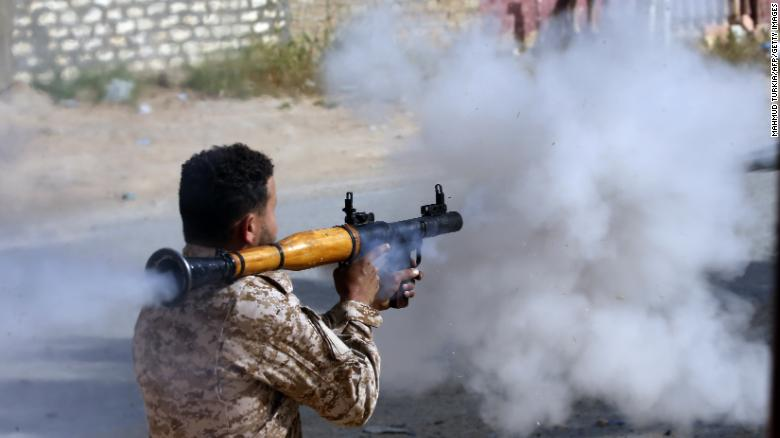 A Libyan fighter loyal to the Government of National Accord fires a rocket propelled grenade during clashes with forces loyal to Haftar south of  Ain Zara, on April 20.