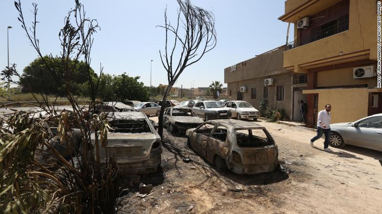 Damaged vehicles are seen after forces led by Haftar carried out rocket attacks in the Abu Salim neighborhood in Tripoli on April 17.