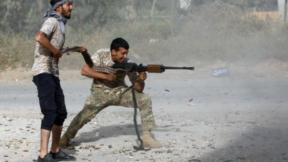 Government of National Accord fighters fire during clashes with Haftar