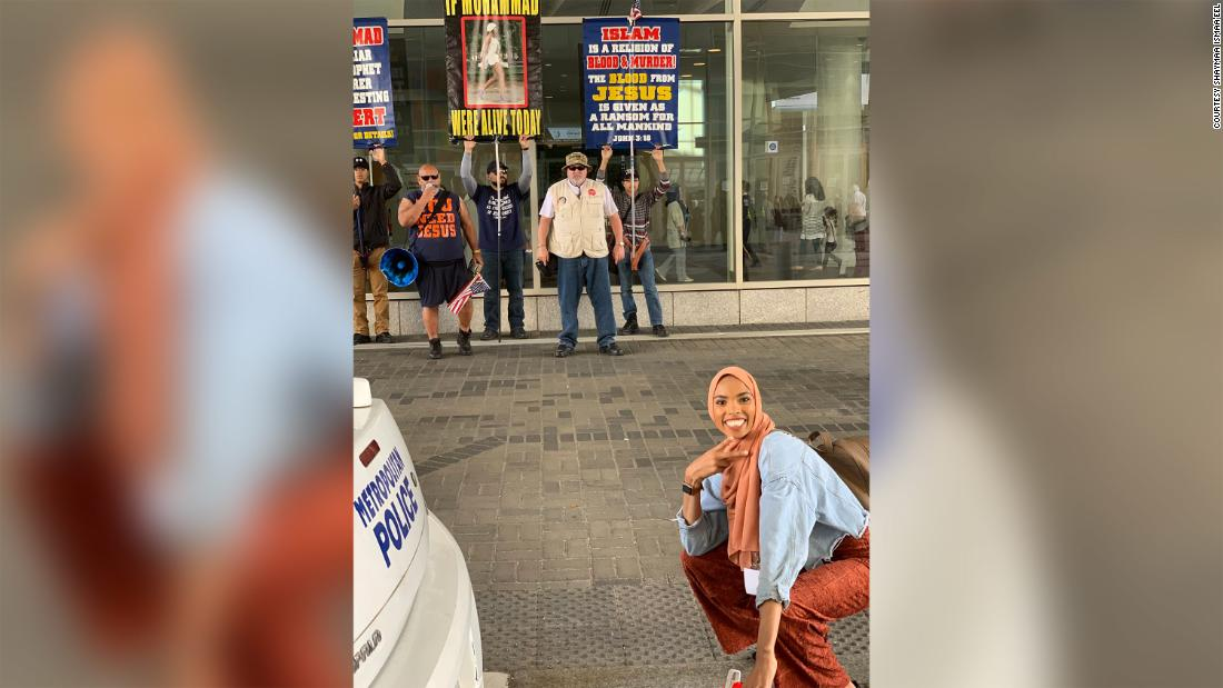 This photo went viral when a woman 'smiled in the face of bigotry'