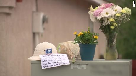 Flowers and a note were placed outside the home where the shooting took place.