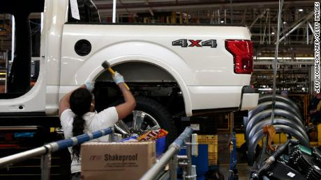 An employee works on the assembly line for the Ford 2018 and 2019 F-150 truck at the Ford Motor Company's Rouge Complex on September 27, 2018 in Dearborn, Michigan. - Ford Motor Company's Rouge complex is the only one in American history to manufacture vehicles  including ships, tractors and cars  non-stop for 100 years. (Photo by JEFF KOWALSKY / AFP)        (Photo credit should read JEFF KOWALSKY/AFP/Getty Images)