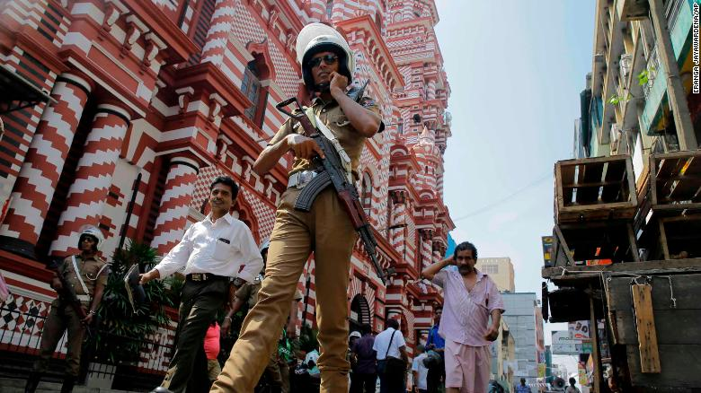 A Sri Lankan police officer patrols out side a mosque in Colombo, Sri Lanka.