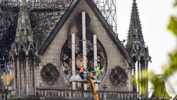 Workers intervene on the northern side of Notre-Dame Cathedral in Paris on April 18, 2019, three days after a fire devastated the landmark in the centre of the French capital.