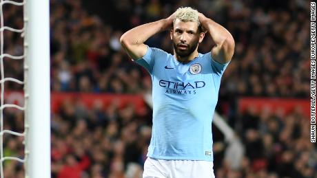 Sergio Aguero of Manchester City puts his head in his hands after his team spurns an opportunity.