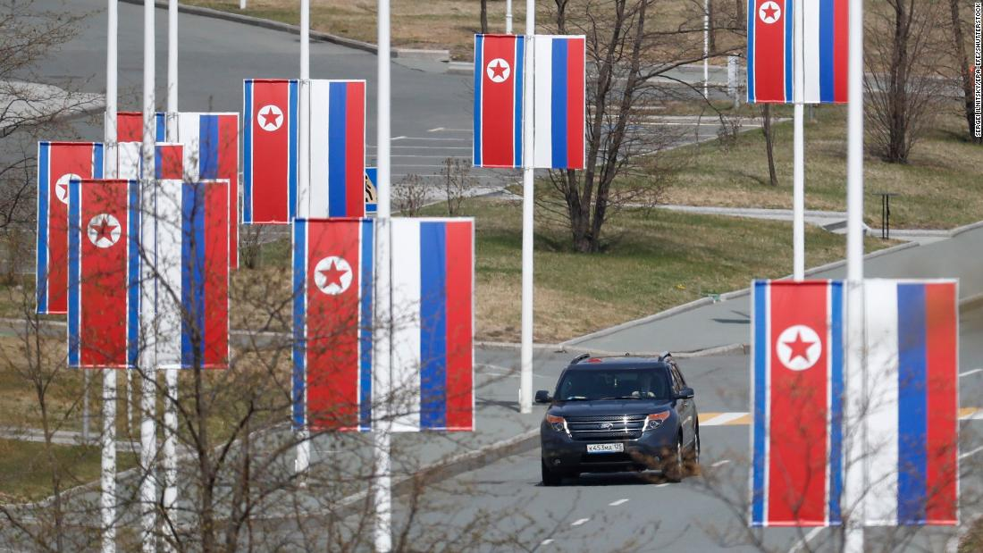 Russian and North Korean flags are seen along a road prior to the meeting of North Korean leader Kim Jong Un and Russian President Vladimir Putin on Russky Island in Vladivostok, Russia, on Thursday.