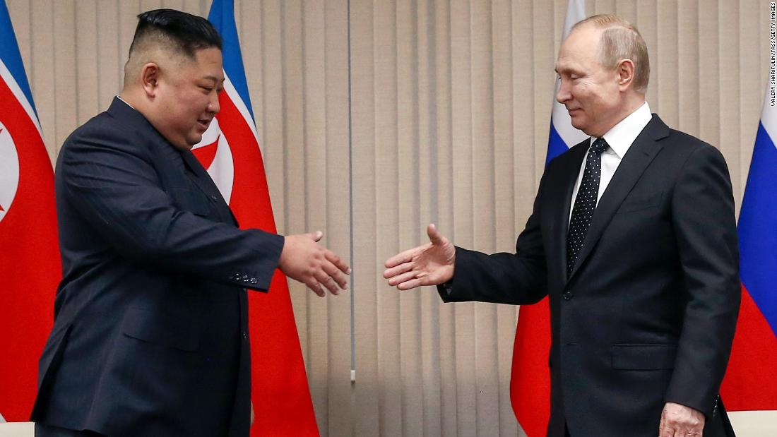 North Korean Leader Kim Jong Un, left, and Russia's President Vladimir Putin shake hands during a meeting at the Far Eastern Federal University (FEFU) on Russky Island, on Thursday.