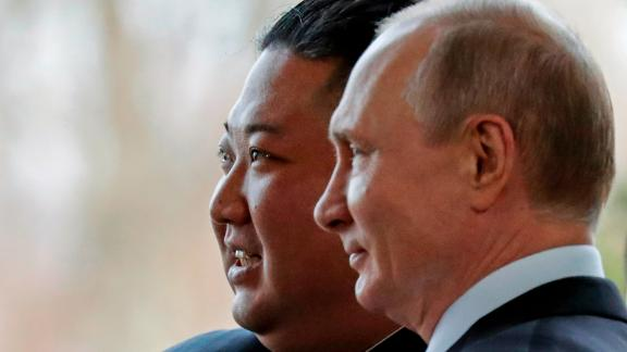 Russian President Vladimir Putin, right, and North Korea