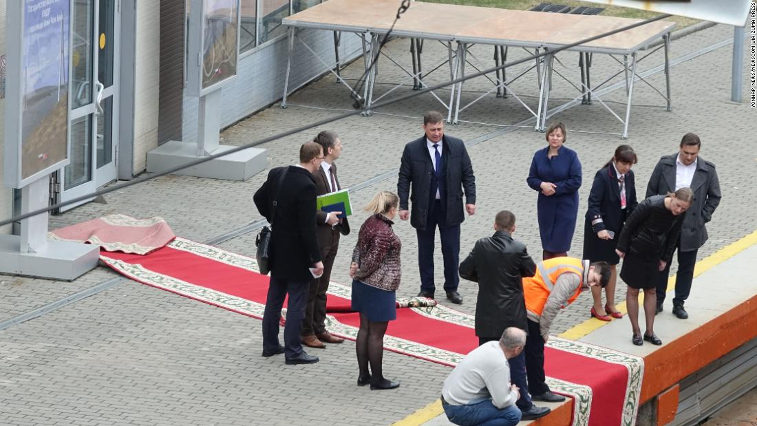 Summit officials from North Korea and Russia lay a red carpet at the railway station in Russia's far eastern city of Vladivostok on Wednesday, April 24, ahead of North Korean leader Kim Jong Un's arrival there for a summit with Russian President Vladimir Putin.