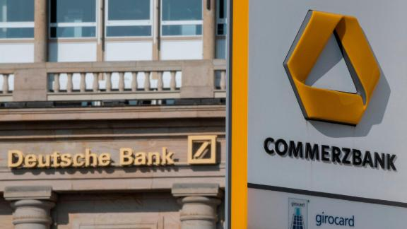 15 April 2019, Hessen, Frankfurt/Main: A branch of Deutsche Bank and Commerzbank is not far apart in the city centre. Financial experts consider a merger of the two credit institutions to be possible. Photo: Boris Roessler/dpa (Photo by Boris Roessler/picture alliance via Getty Images)