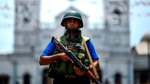 A soldier stands guard outside St. Anthony's Shrine in Colombo, one of the Easter Sunday targets.