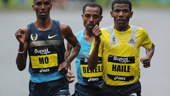 Farah  (L) competes alongside Gebrselassie at the 2013 Great North Run.