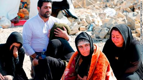 Iranians mourn after a 2017 earthquake in Kermanshah province. Iran was the fifth most negative country last year, a global survey found.