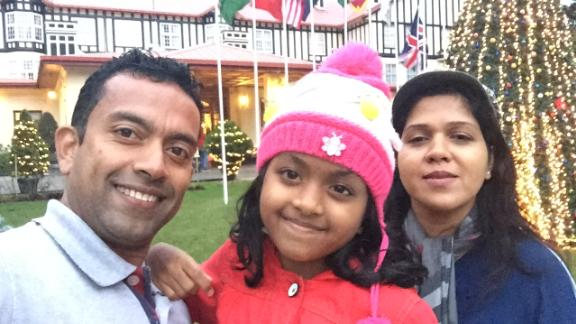 Sudesh Kolonne, Alexendria Kolonne and  Manik Suriyaaratchi pose for a family picture.