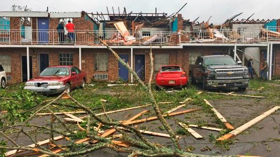 People survey damage at a motel that was slammed by a tornado Thursday in Ruston, Louisiana.