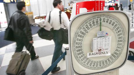 Can weighing passengers at airports help cut carbon emissions?