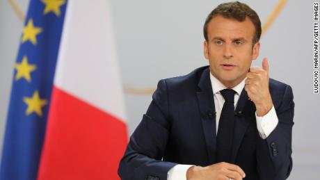 Macron pledges tax cuts in effort to assuage Yellow Vests