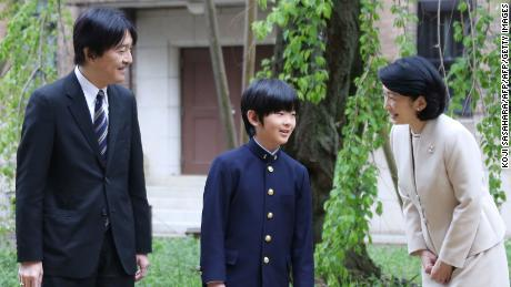 Japan's Prince Hisahito with his parents, Prince Akishino and Princess Kiko,  before attending the entrance ceremony at Ochanomizu University junior high school in Tokyo on April 8, 2019.