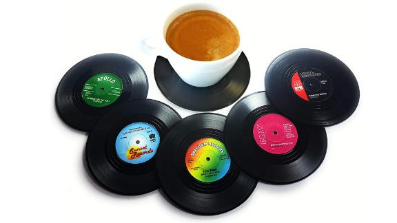 """<strong>Vinyl Record Disc Coasters ($4.10; </strong><a href=""""https://amzn.to/2DAlU7B"""" target=""""_blank"""" target=""""_blank""""><strong>amazon.com</strong></a><strong>)</strong>"""