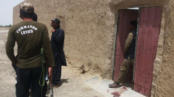 Pakistani security officials gather at the site of an attack by gunmen on a polio vaccination team in Balochistan province on Thursday.