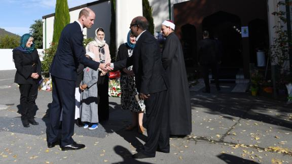 Prince William greets members of the Muslim community as he arrives at the Al Noor mosque Friday.