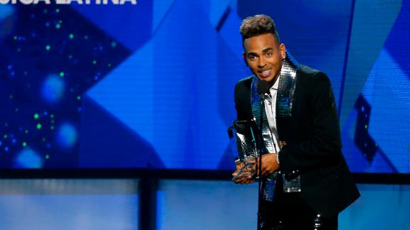 "Ozuna accepts the award for Latin rhythm solo artist of the year and top Latin album of the year for ""Odisea"" at the Billboard Latin Music Awards on Thursday, April 25, 2019, at the Mandalay Bay Events Center in Las Vegas."