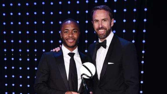 Raheem Sterling poses alongside England manager Gareth Southgate, who handed the winger his special award.