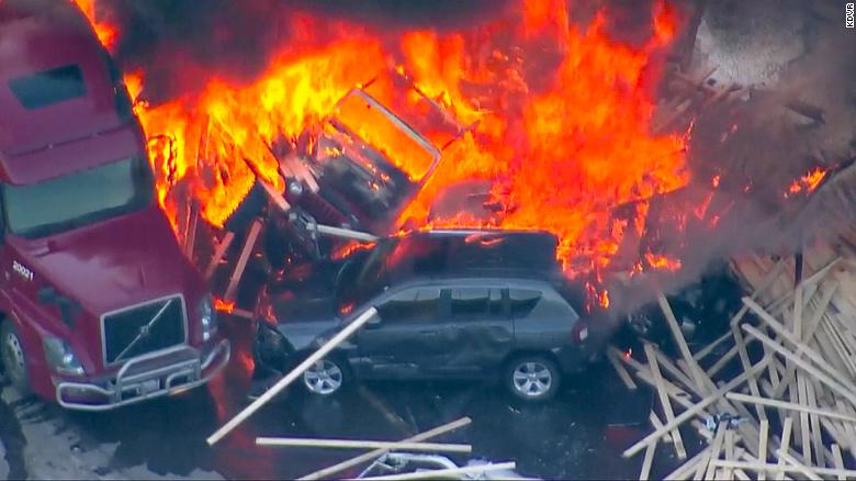 Semi plows into snarled traffic, ignites massive fire