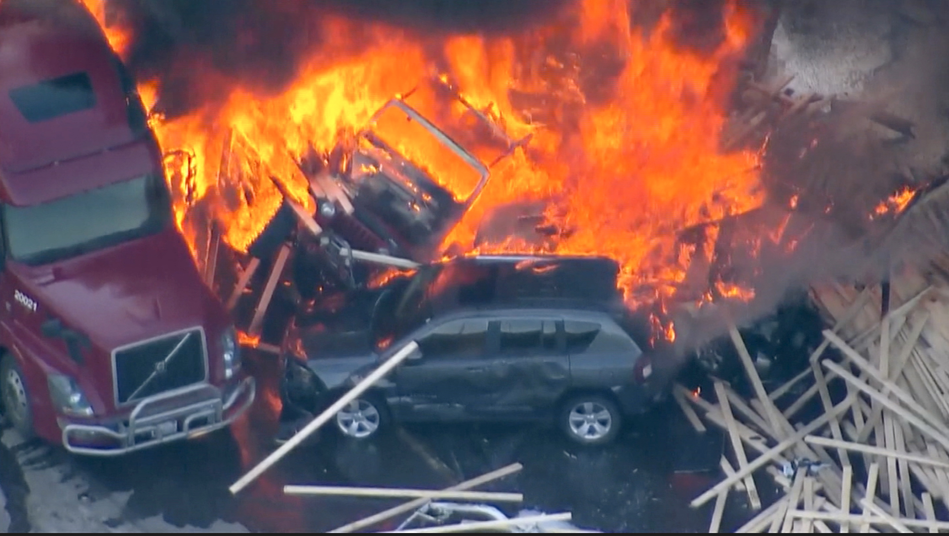Semi plows into snarled traffic, ignites massive fire