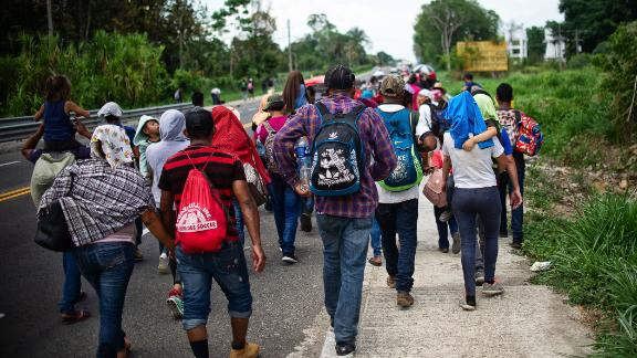 "Central American migrants heading to the US walk in caravan along the road between Metapa and Tapachula in Mexico on April 12, 2019. - A group of 350 Central American migrants forced their way into Mexico Friday, authorities said, as a new caravan of around 2,500 people arrived -- news sure to draw the attention of US President Donald Trump. Mexico's National Migration Institute said some members of the caravan had a ""hostile attitude"" and had attacked local police in the southern town of Metapa de Dominguez after crossing the border from Guatemala. (Photo by PEP COMPANYS / AFP)        (Photo credit should read PEP COMPANYS/AFP/Getty Images)"