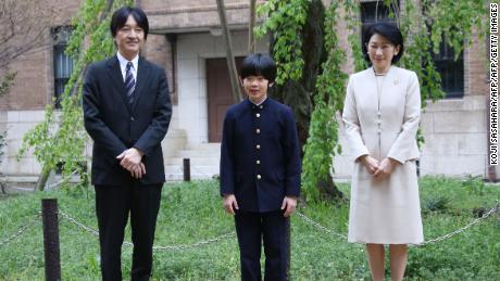Japan's Prince Hisahito, accompanied by his parents, Prince Akishino and Princess Kiko, poses for photos at Ochanomizu University Junior High School  in Tokyo before attending the entrance ceremony on April 8, 2019.