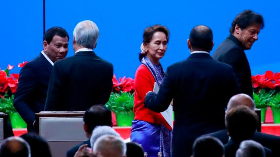 Philippines President Rodrigo Duterte (L), Myanmar State Councilor Aung San Suu Kyi (C) and Pakistani Prime Minister Imran Khan (R) arrive for the opening ceremony on April 26.