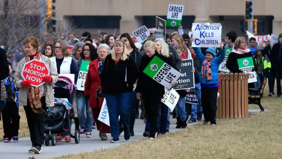 In this Jan. 23, 2017, file photo, marchers arrive for a Roe v. Wade protest as hundreds converge on the Kansas Statehouse to mark the 1973 Supreme Court decision that legalized abortion nationwide. Abortion opponents have been bracing themselves for nearly two years for a ruling from Kansas' highest court that protects abortion rights and upends politics in a state long at the center of the national debate.