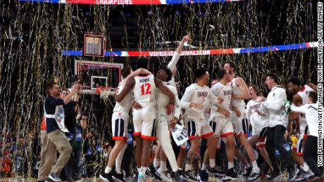 The Virginia Cavaliers celebrate their teams 85-77 win over the Texas Tech Red Raiders to win the the 2019 NCAA men's Final Four National Championship game at U.S. Bank Stadium.