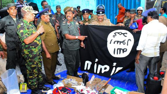 In this picture taken on April 26, 2019, security personnel inspects seized items after they raid what believed to be an Islamist safe house in the eastern town of Kalmunai. - Fifteen people, including six children, died during a raid by Sri Lankan security forces as three cornered suicide bombers blew themselves up and others were shot dead, police said on April 27. (Photo by STRINGER / AFP)        (Photo credit should read STRINGER/AFP/Getty Images)