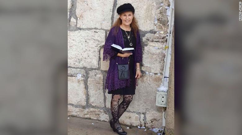 Woman killed while protecting rabbi during shooting