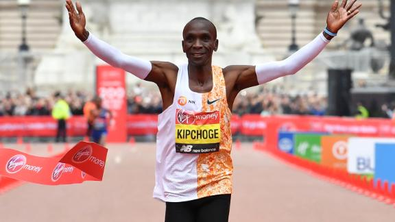 Kipchoge crosses the finish line to win the London Marathon.