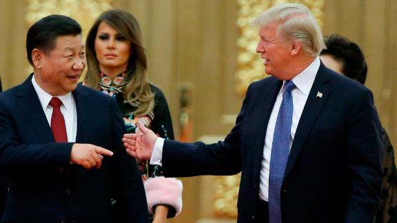 BEIJING, CHINA - NOVEMBER 9: U.S. President Donald Trump and China's President Xi Jinping arrive at a state dinner at the Great Hall of the People on November 9, 2017 in Beijing, China. Trump is on a 10-day trip to Asia.  (Photo by Thomas Peter - Pool/Getty Images)