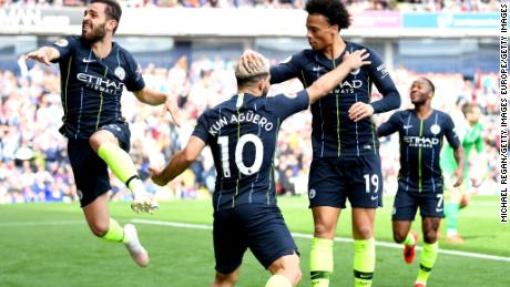 Manchester City celebrates scoring the important goal against Burnley.