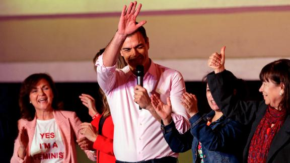 Spanish Prime Minister and Socialist Party candidate Pedro Sanchez waves to supporters gathered at the party headquarters waiting for results of the general election in Madrid, Sunday, April 28, 2019. Spain's governing Socialists won the country's national election Sunday but will need the backing of smaller parties to stay in power, while a far-right party rode a groundswell of support to enter the lower house of parliament for the first time in four decades, provisional results showed. At left is his wife Maria Begona Gomez. (AP Photo/Andrea Comas)