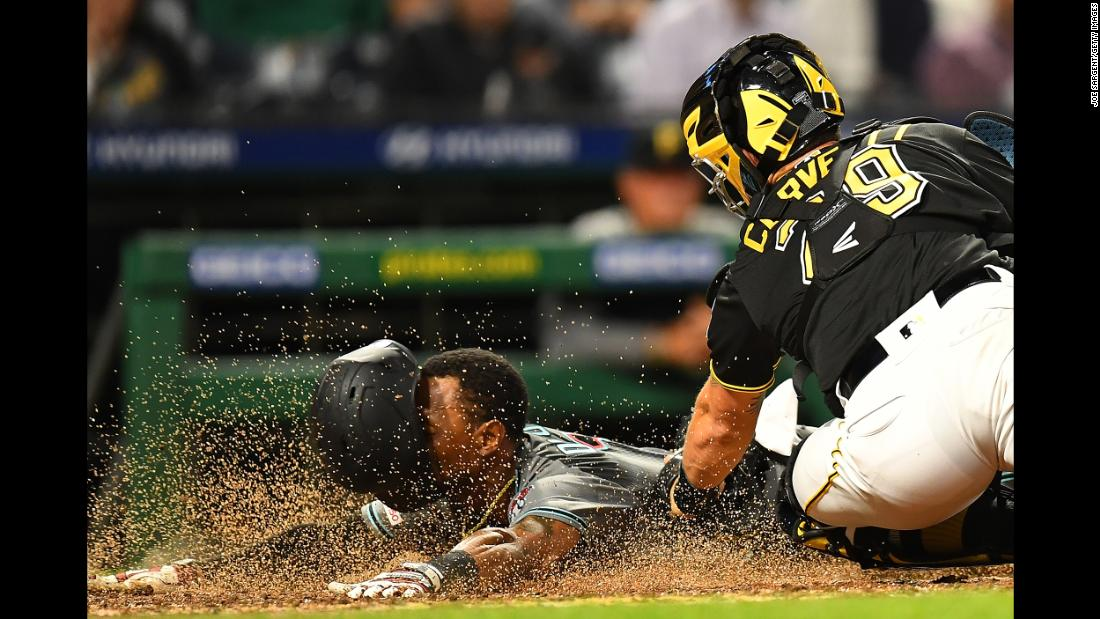 Jarrod Dyson of the Arizona Diamondbacks scores in front of Francisco Cervelli of the Pittsburgh Pirates during the sixth inning at PNC Park in Pittsburgh, Pennsylvania, on Tuesday, April 23.