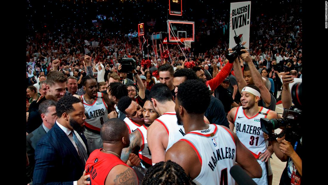 Portland Trail Blazers guard Damian Lillard reacts after making the game-winning shot at the buzzer against the Oklahoma City Thunder after Game 5 of an NBA basketball first-round playoff series in Portland, Oregon, on Tuesday, April 23.