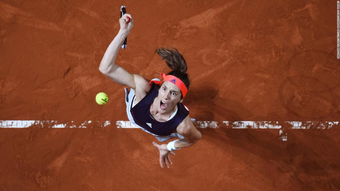Andrea Petkovic of Germany serves against Sara Sorribes Tormo of Spain at the women's first ground Porsche Grand Prix in Baden-Wuerttemberg, Germany on Tuesday, April 23.
