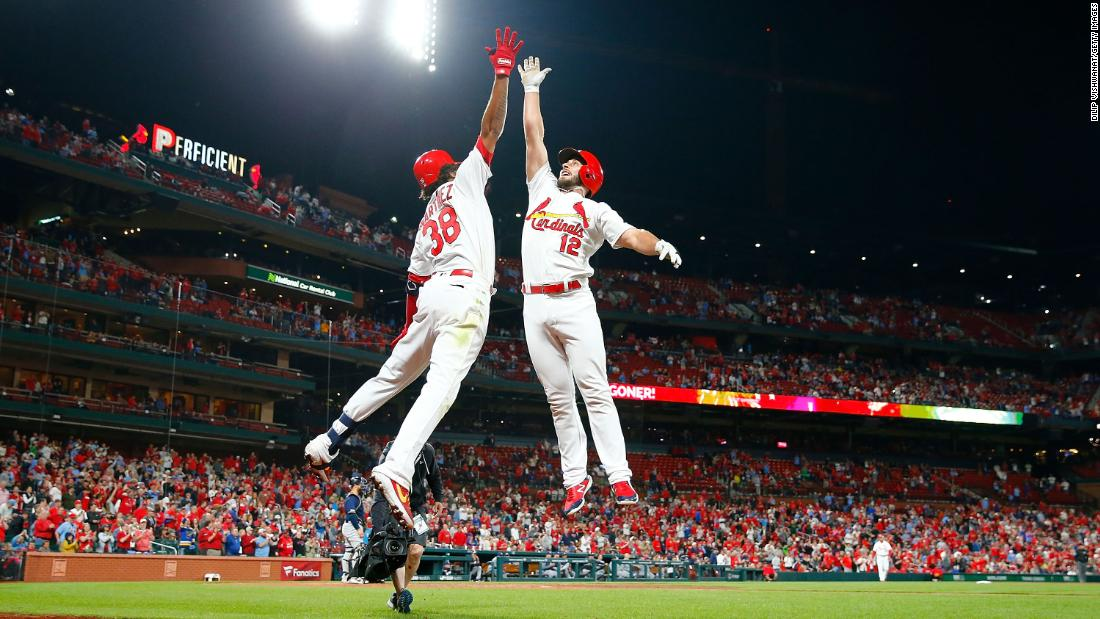 José Martínez of the St. Louis Cardinals, left, congratulates teammate Paul DeJong after he hit a home run against the Milwaukee Brewers in the eighth inning at Busch Stadium in St. Louis, Missouri, on Tuesday, April 23.