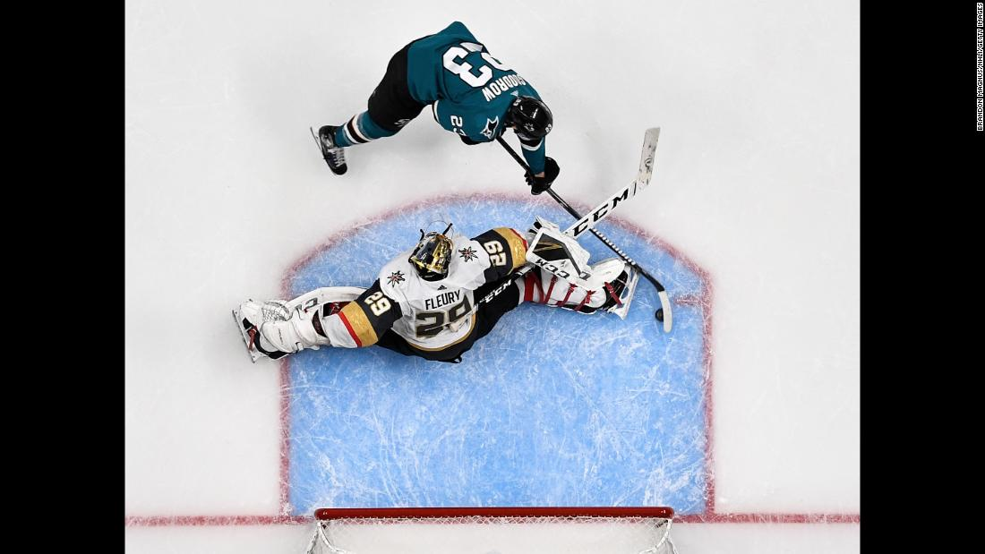 Barclay Goodrow, top, of the San Jose Sharks scores the game-winning goal against Marc-Andre Fleury of the Vegas Golden Knights in Game Seven of the Western Conference First Round during the 2019 NHL Stanley Cup Playoffs at SAP Center in San Jose, California, on Tuesday, April 23.