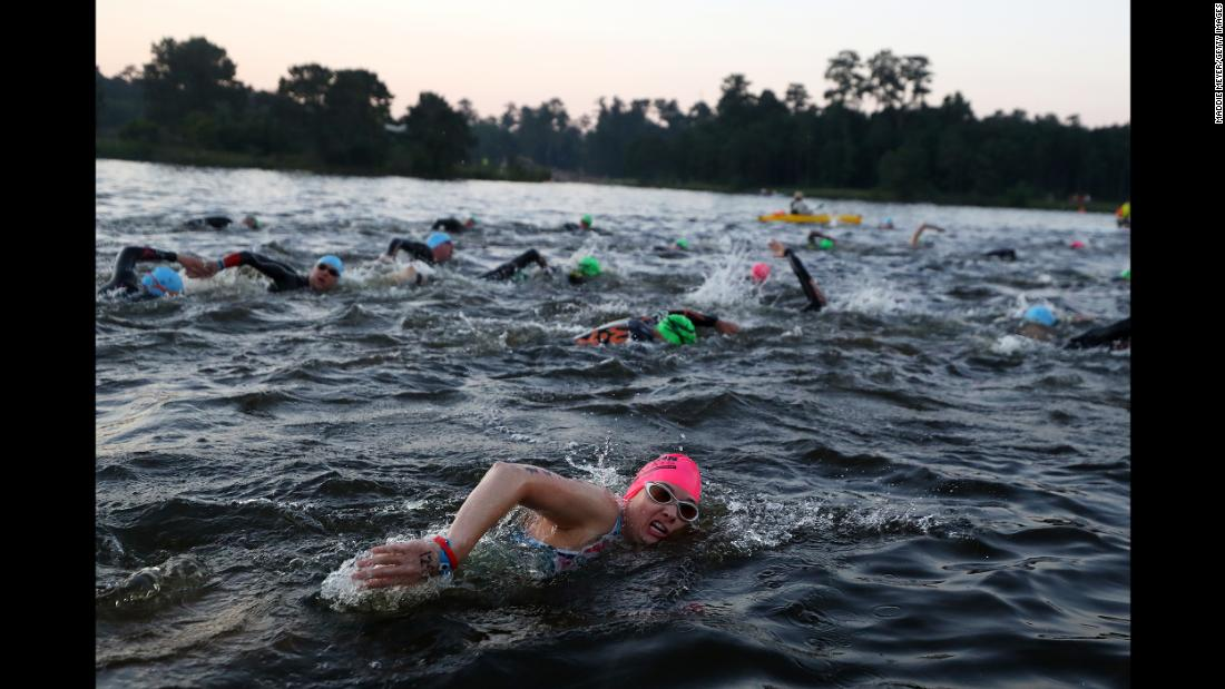 Athletes compete in the swim portion of The Memorial Hermann IRONMAN North American Championship in The Woodlands, Texas, on Saturday, April 27.