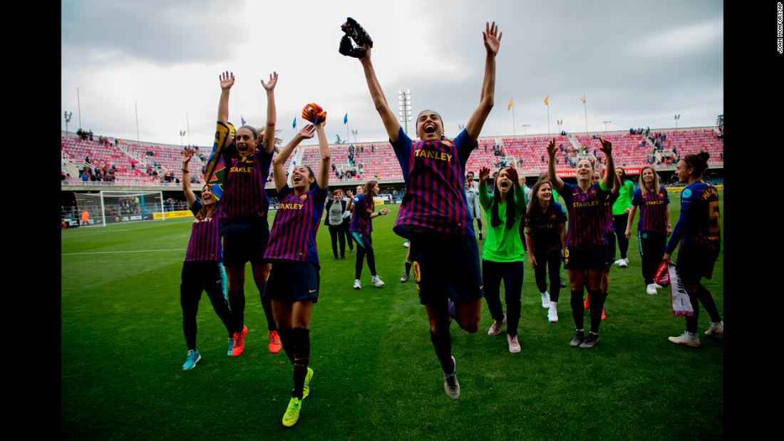 FC Barcelona players celebrate at the end of the Women's Champions League semifinal second leg soccer match between FC Barcelona and Bayern Munich at the Mini Estadi stadium in Barcelona, Spain, on Sunday, April 28.
